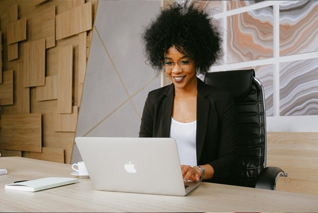 Online CHW training tools - African American woman in front of a computer